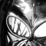 """Silver-faced mask in the short film """"The Old Man's Pendant II"""""""