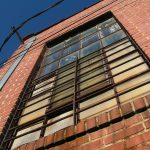 Old window with bars in downtown Siler City