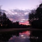 Pond on a golf course at sunset